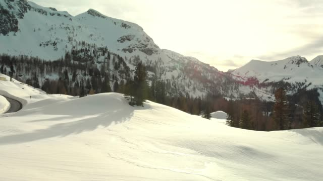 sun rays peaking over the snowy mountains - steep hill stock videos & royalty-free footage