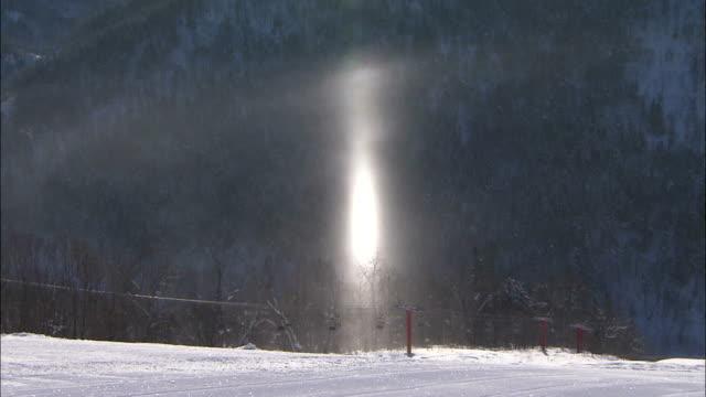 Sun rays reflect off snow, Japan