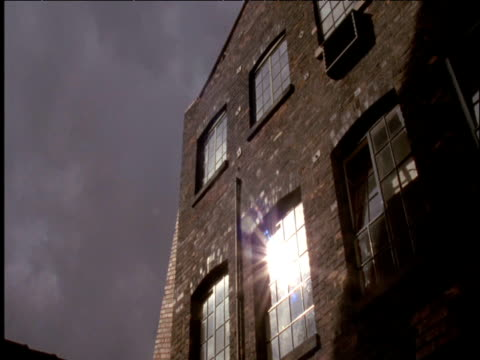 Sun reflected in windows of traditional pottery factory West Midlands