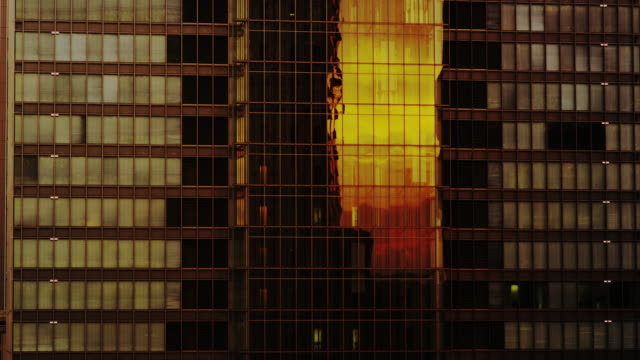 sun reflecting from office building - curtain wall facade stock videos and b-roll footage