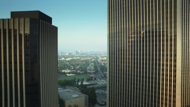 sun reflecting on office building in century city, los angeles - century city stock videos & royalty-free footage