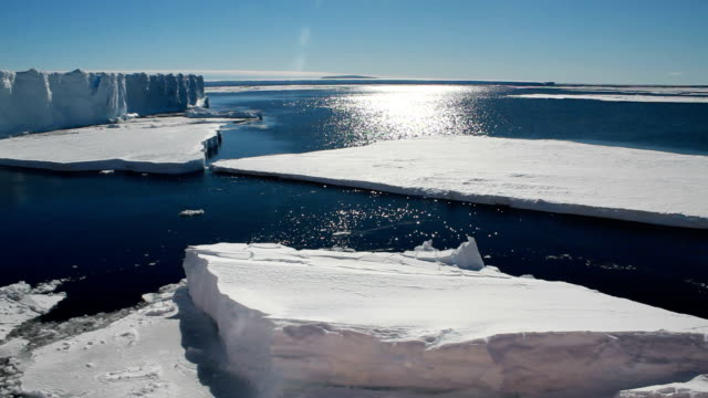 sun reflection over broken floating ice sheets, antarctica - south pole stock videos and b-roll footage