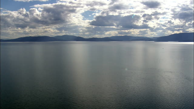 sun reflections over flathead lake  - aerial view - montana, lake county, united states - flathead lake stock videos and b-roll footage