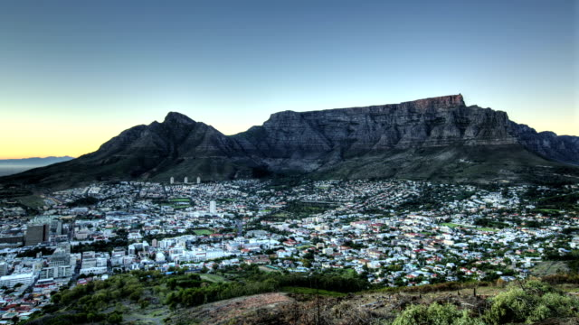 Sun rise lights up Table mountain and city in the foreground