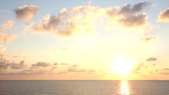 Sun rises above Mediterranean Sea, ship view