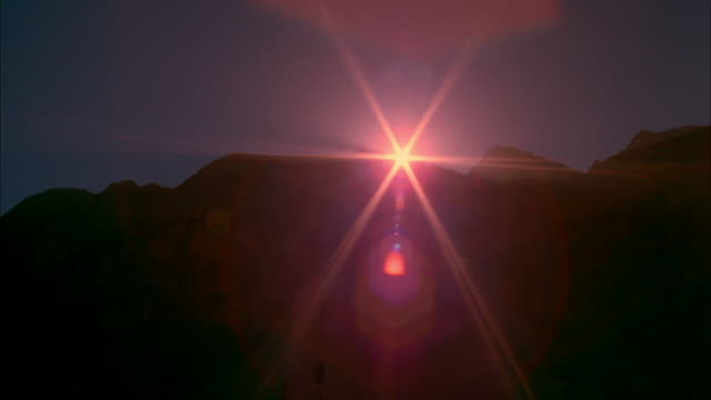 vidéos et rushes de sun rises from behind the atlas mountains available in hd. - maroc