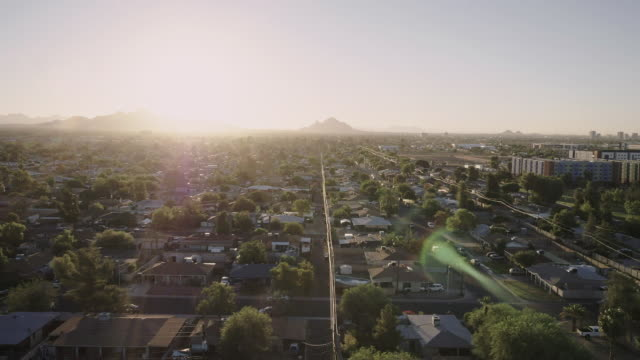 sun rises over city residential neighborhood - arizona stock-videos und b-roll-filmmaterial
