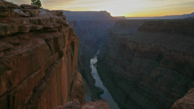 TIME LAPSE MEDIUM SHOT sun rises over Grand Canyon and Colorado River at Toroweap Overlook, Arizona