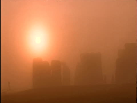 sun rises over misty stonehenge wiltshire - obelisk stock videos & royalty-free footage
