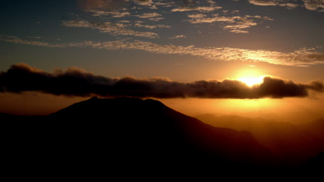 Sun rises over mountains, Marojejy, Madagascar