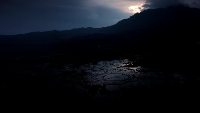 sun rises over rice paddy terraces, yuanyang, yunnan, china - rice terrace stock videos and b-roll footage