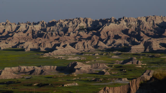 tl sun rises over rocky landscape, badlands, usa - south dakota stock videos & royalty-free footage