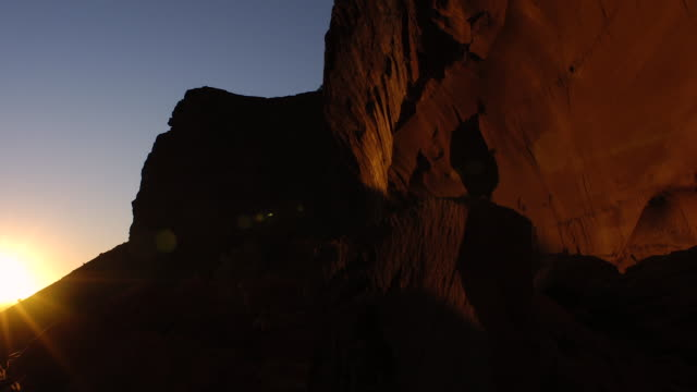 tl sun rises over sandstone rockface, australia - sedimentary rock stock videos & royalty-free footage