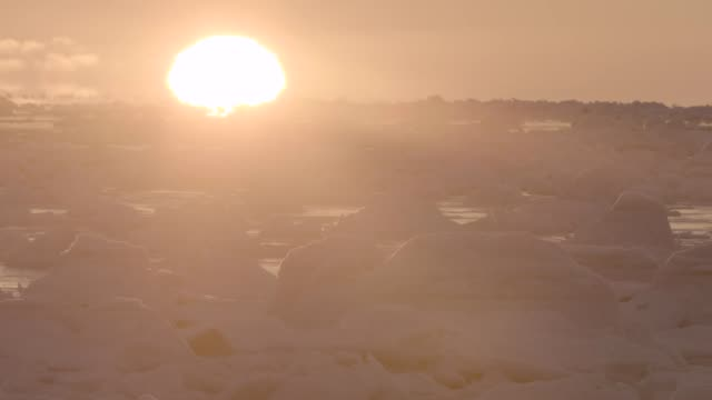 sun rises over sea ice, canada - arctic stock videos & royalty-free footage