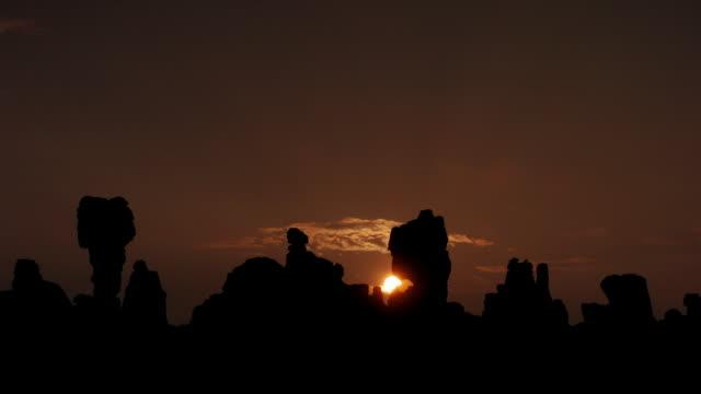 Sun rises over Shilin stone forest, Yunnan, China