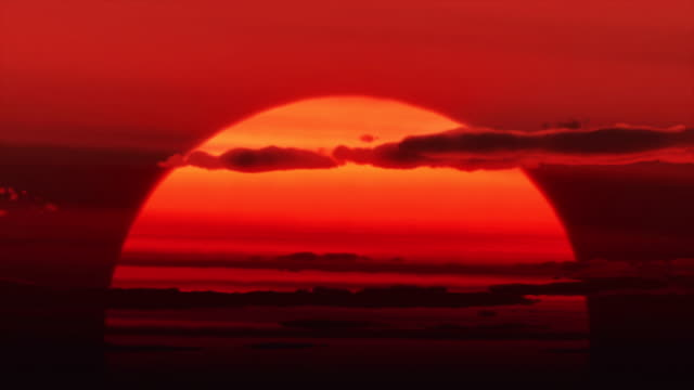 huge sun rises - in front of stock videos & royalty-free footage
