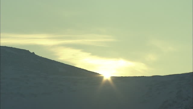 sun rises_daisetsuzan volcanic group in winter, hokkaid_ - daisetsuzan volcanic group stock videos and b-roll footage