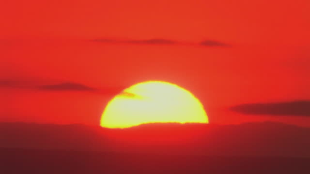 T/L, MS, Sun rising against orange sky, Masai Mara, Kenya