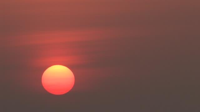 ms, sun rising against smoky sky, varanasi, uttar pradesh, india - pastel stock videos & royalty-free footage