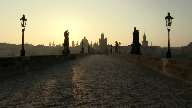 ms sun rising front of charles bridge / prague, hlavni mesto praha, czech republic - charles bridge stock videos and b-roll footage