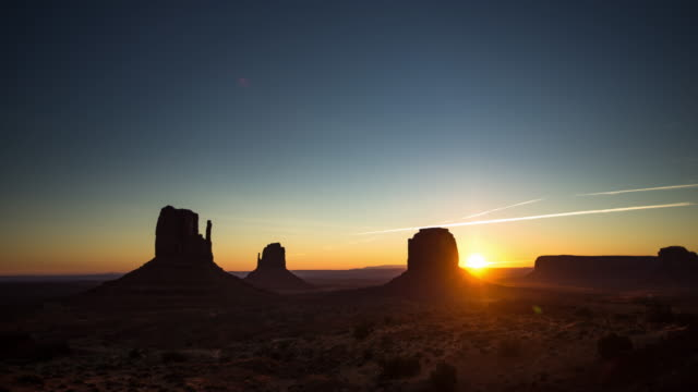 sun rising in monument valley - time lapse - red rocks stock videos & royalty-free footage