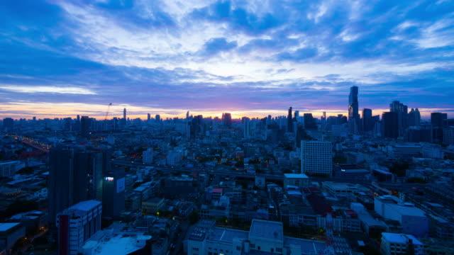 Sun rising over Bangkok city skyline