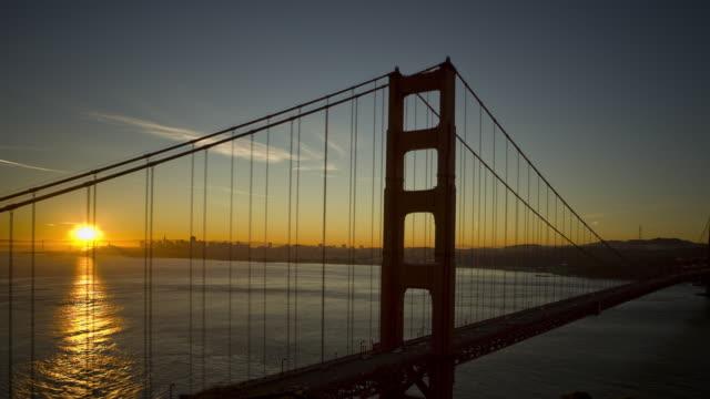T/L HA WS ZO Sun rising over Golden Gate Bridge and San Francisco Bay / San Francisco, California, USA