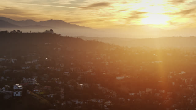 sun rising over hollywood hills - aerial view - 30 seconds or greater stock videos & royalty-free footage