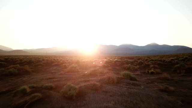 sun rising over ridge of mountains in california - plain stock videos & royalty-free footage