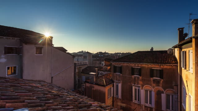 sun rising over venice rooftops - time lapse - mediterranean culture stock videos & royalty-free footage