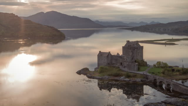sun set over eilean donan castle on loch duich in the scotish highlands - castle stock videos & royalty-free footage