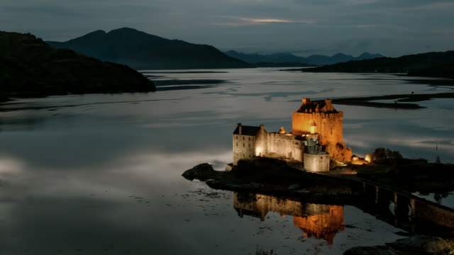 sun set over eilean donan castle on loch duich in the scotish highlands - loch duich stock videos & royalty-free footage