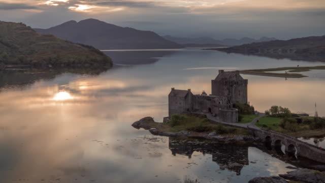 Sun set over Eilean Donan Castle on Loch Duich in the Scotish Highlands