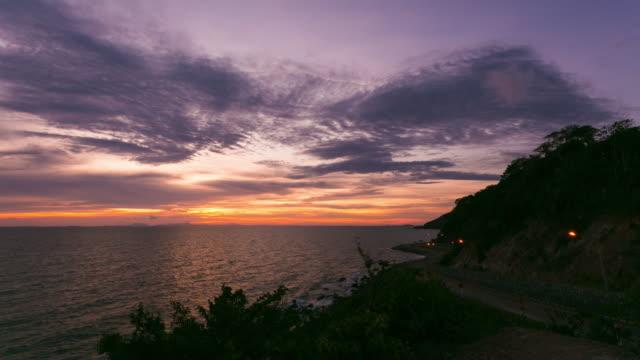 Sun set twilight coast line curvy road, Time lapse
