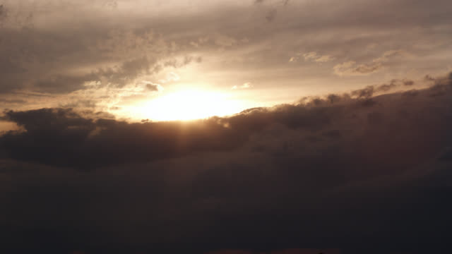 tl sun sets behind billowing clouds, delaware - behind stock videos & royalty-free footage