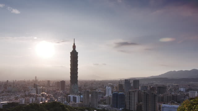 t/l ws ha sun sets behine taipei city skyline - taipei 101 stock videos & royalty-free footage