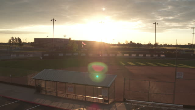 sun sets over a baseball field - stadium stock videos & royalty-free footage