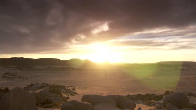 Sun sets over desert Djanet Algeria Available in HD.