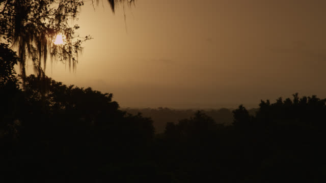 """Sun sets over forest, Calakmul, Mexico"""