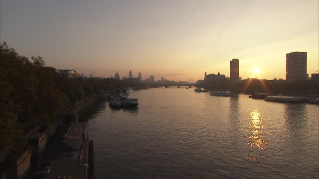 Sun sets over the River Thames London Available in HD.