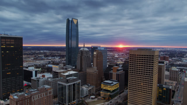 sun setting behind downtown oklahoma city - aerial view - real time stock videos & royalty-free footage