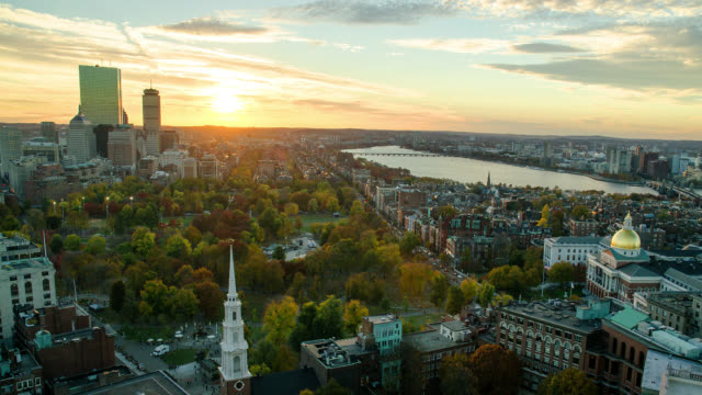t/l wa ha sun setting behind downtown skyline  / boston - boston massachusetts stock videos & royalty-free footage