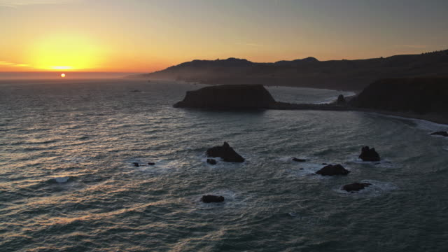 Sun Setting Behind Goat Rock, California - Drone Shot