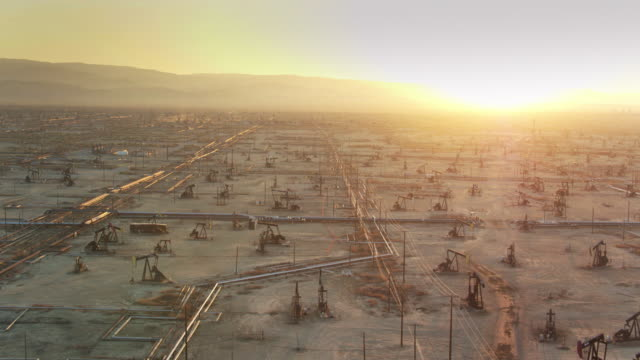 Sun Setting Behind Hills in Vast South Belridge Oil Field - Drone Shot