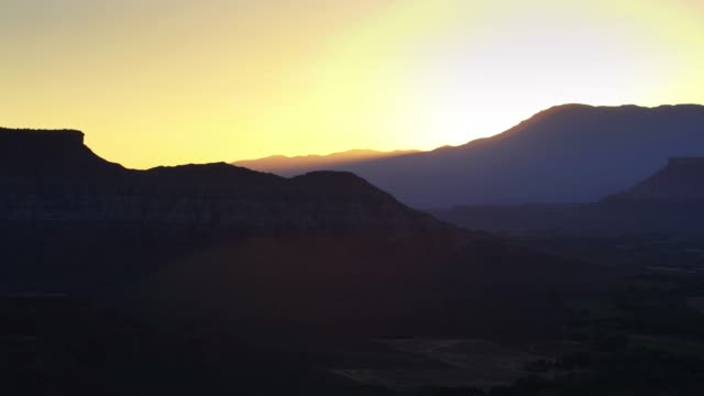 sun setting behind mountain near zion national park - drone shot - zion national park stock videos & royalty-free footage