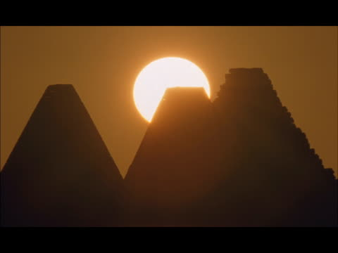 MS, Sun setting behind silhouettes of three pyramids, Gebel Barkal, Sudan, Africa