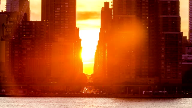 sun setting on 34th st in nyc manhattanhenge - moving towards stock videos & royalty-free footage