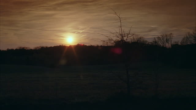 WS Sun setting on horizon / Newnan, Georgia, United States