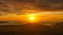 Sun Setting on Sea Horizon at Golden Hour Sunset in Kota Kinabalu Sabah