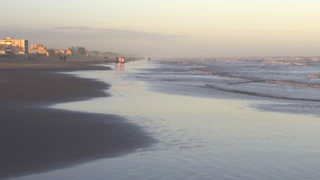 sun setting on the beach in southern brazil - brasile meridionale video stock e b–roll